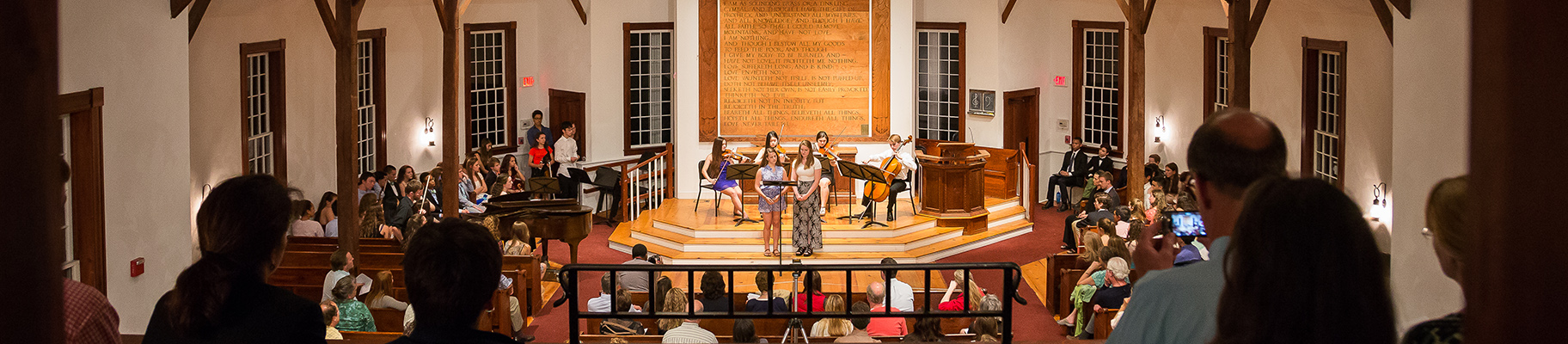 A performance in the Elizabeth B. Hall Chapel at Concord Academy