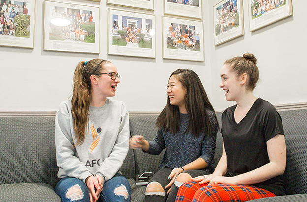 Concord Academy students talking in the Haines House common room