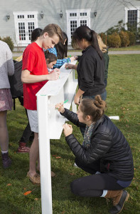 Concord Academy students signing a beam for CA Labs