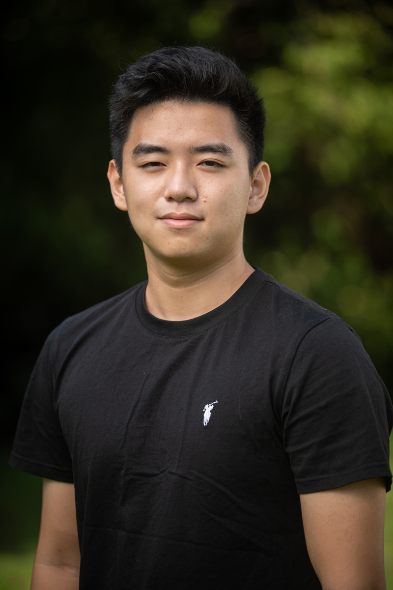 """Gary Sun poses for his headshot during the """"Annual Head Tour Guide Photoshoot"""" outside the Chapel on Sep. 13, 2021."""