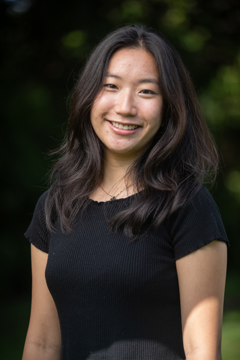 """Kelly Zhang poses for their headshots during the """" Annual Head Tour Guide Photoshoot"""" outside the Chapel on Sep. 13, 2021."""